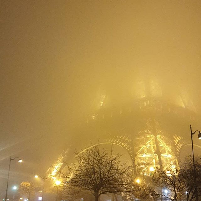 Eiffel tower at night in mist