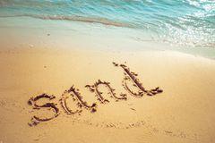 sand written on beach